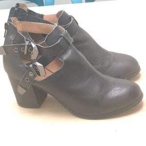 Black ankle booties with buckle detail
